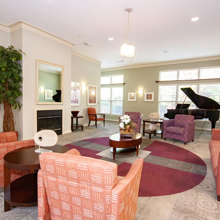 Great room with piano at Columbia Blackshear Senior Residences - Senior Apartments in Atlanta, GA