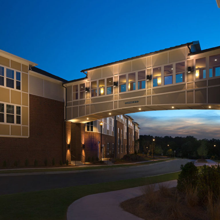 Pathway between apartment buildings at Columbia Brookside Senior Residences - Senior Apartments in Athens, GA