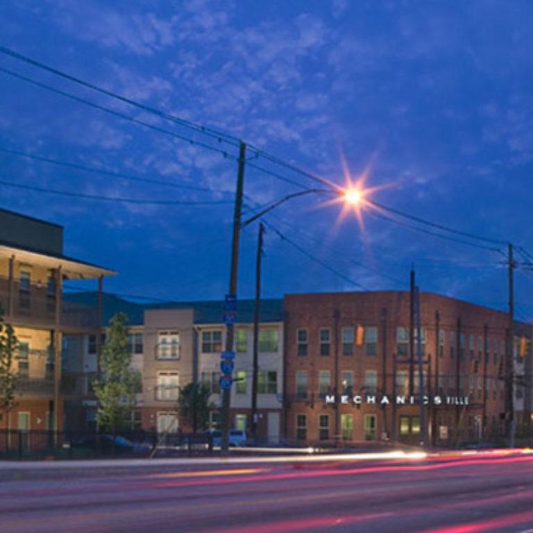 Street view of Columbia Mechanicsville Community at night- Apartments in Atlanta, GA