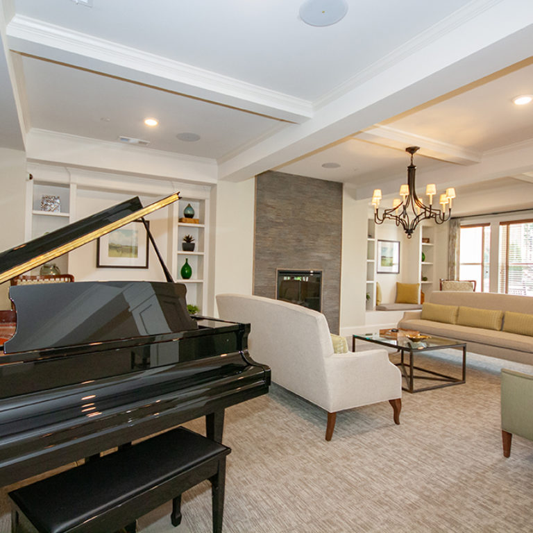 Great room with piano at Columbia Senior Residences at Forrest Hills - Senior Apartments at Decatur, GA