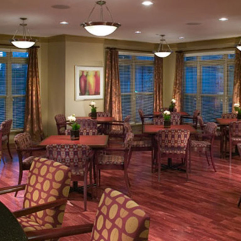 Community room at Columbia Senior Residences at MLK Village with lake - Senior Apartments in Atlanta, GA