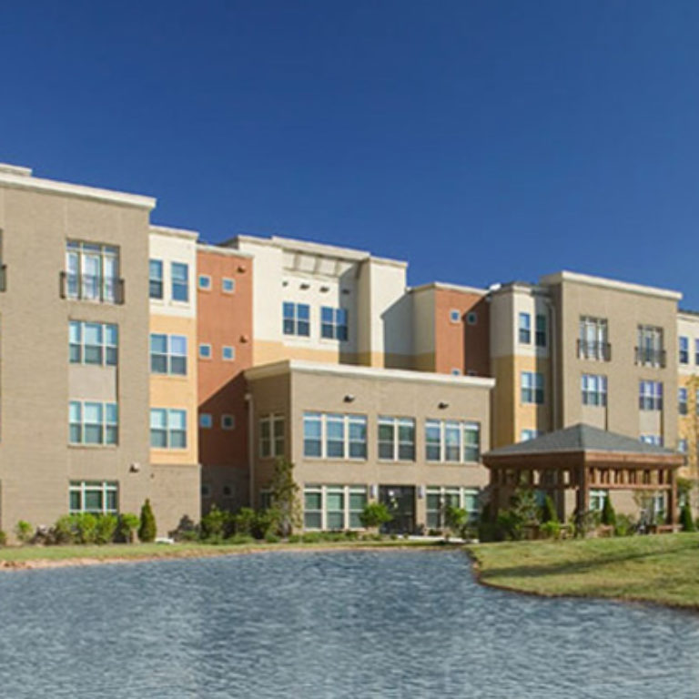 Exterior view of Columbia Senior Residences at MLK Village with lake - Senior Apartments in Atlanta, GA