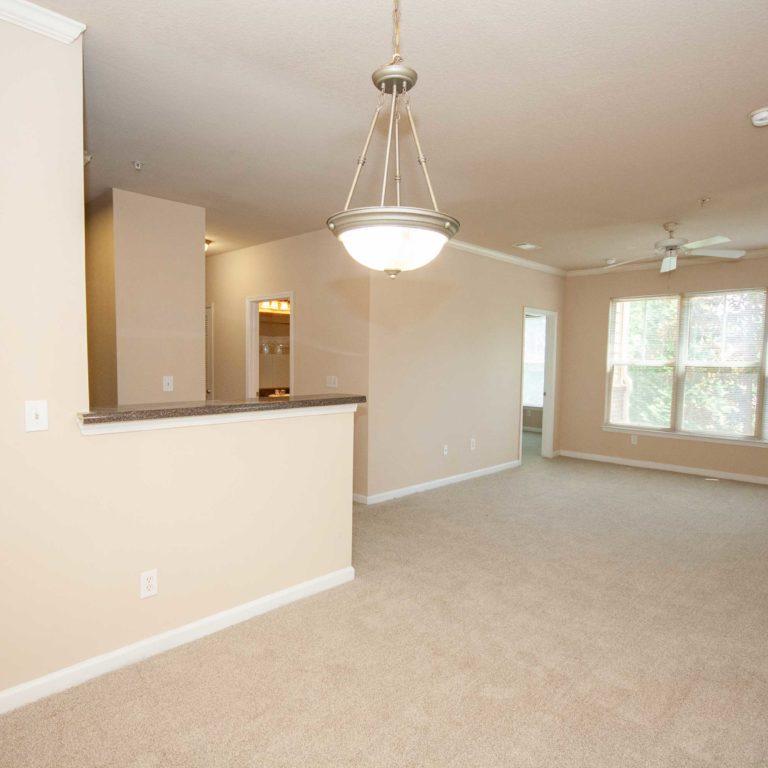 Dining and living room interior at Constitution Apartments - Apartments in Atlanta, GA