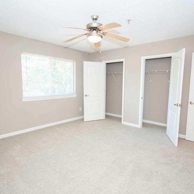 Interior bedroom with spacious closets at Park Commons Apartments Community - Senior Apartments in Atlanta, GA