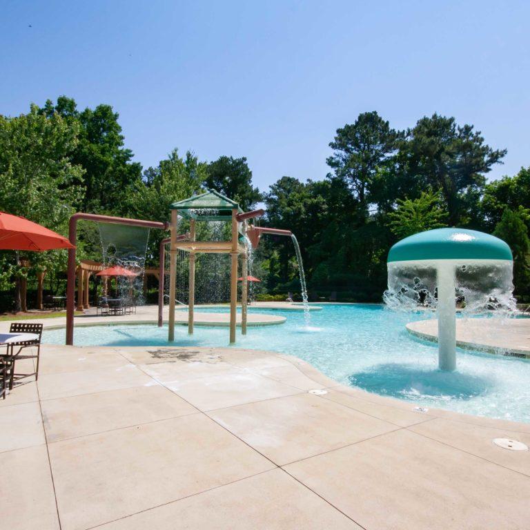 Children's splash zone and sitting area at Park Commons Apartments Community - Senior Apartments in Atlanta, GA