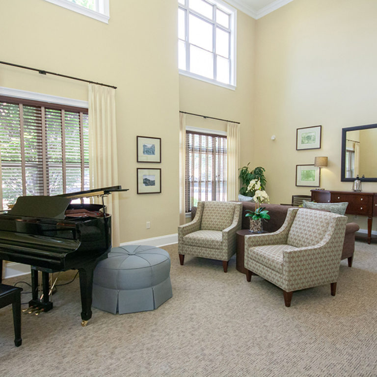 Great room with piano at The Retreat at Dorsey Manor - Senior Apartments in Marietta, GA