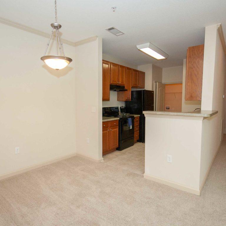 Dining and kitchen at Columbia at South River Gardens - Apartments in Atlanta, GA