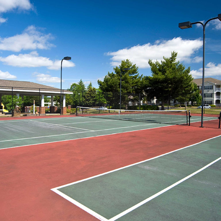 Tennis courts at The Villages of East Lake - Apartments in East Atlanta, GA