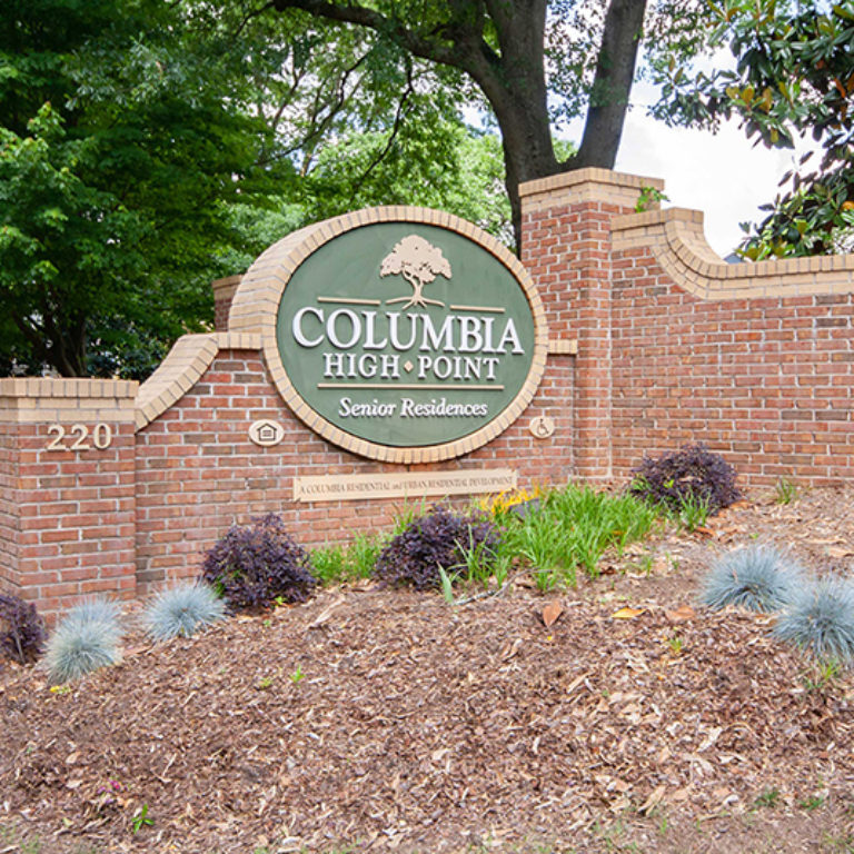 Community signage at Columbia High Point Senior Residences - Apartments in Atlanta, GA
