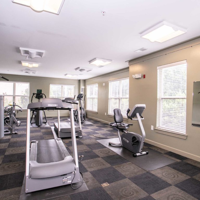 Fitness center at Columbia Senior Residences at Edgewood - Apartments in Atlanta, GA