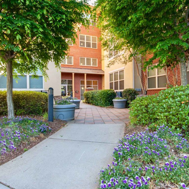 Gardens and pathways at Columbia Blackshear Senior Residences - Senior Apartments in Atlanta, GA