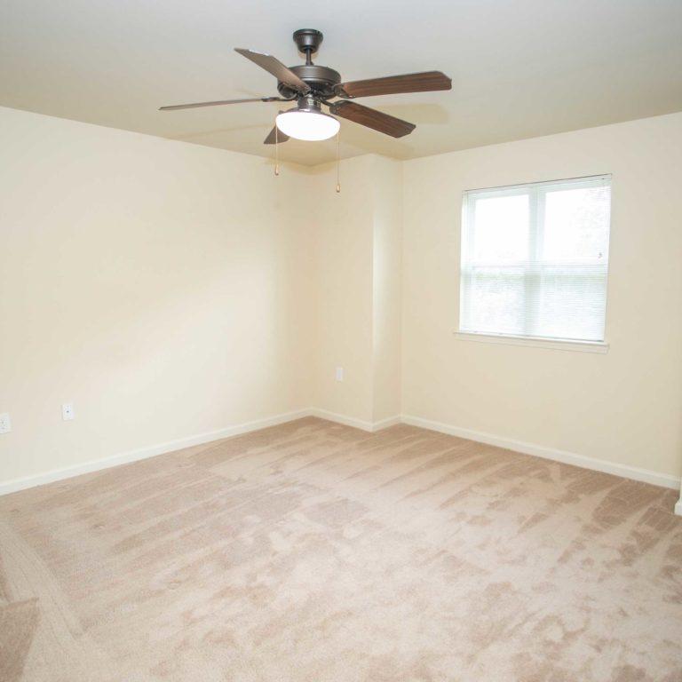 Apartment bedroom at The Retreat at Edgewood Townhomes - Apartments in Atlanta, GA