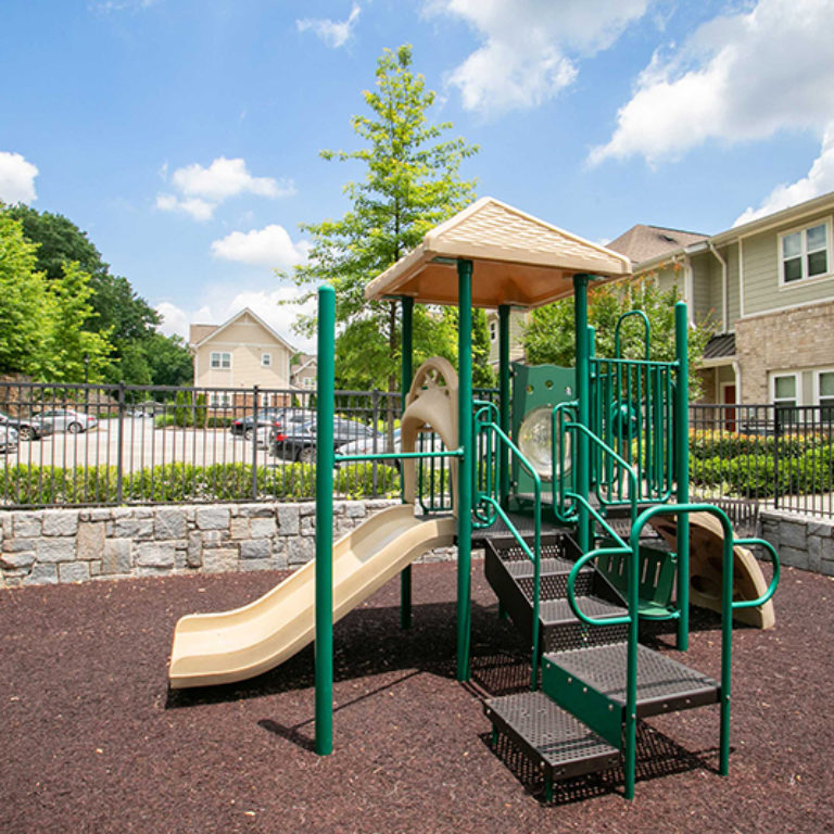 Playground at The Retreat at Edgewood Townhomes - Apartments in Atlanta, GA